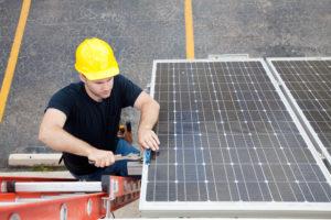 Contractor adjusting solar panel