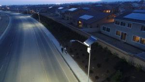 People walking past solar street lights in Beaumont, California